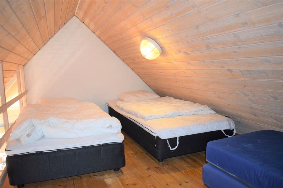 Eines der 2 Schlafzimmer im ersten Stock im jeden Hauses