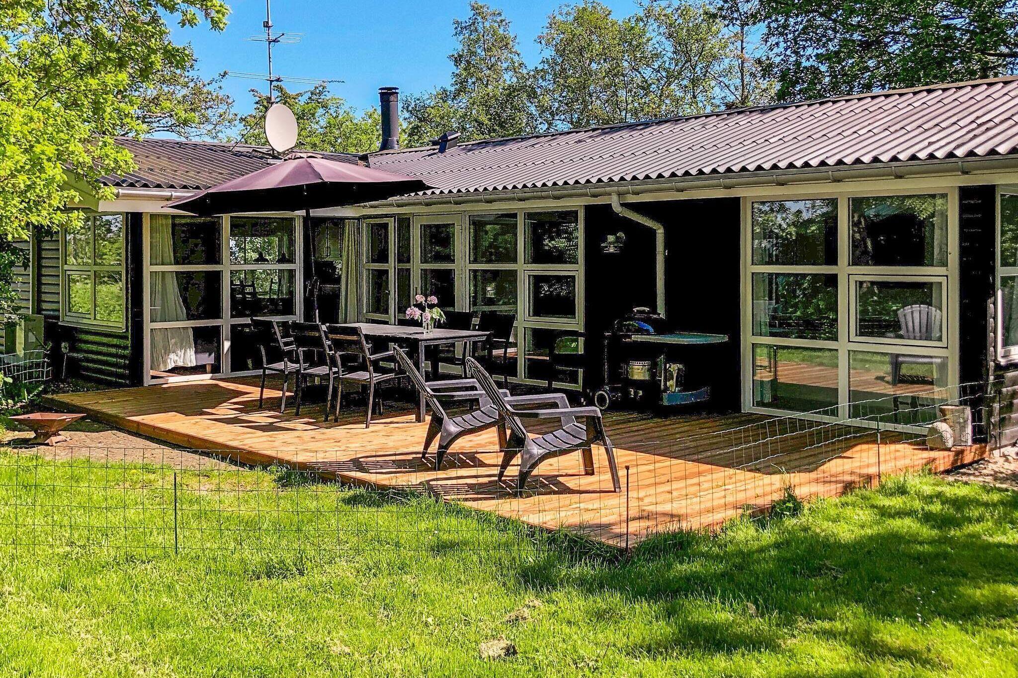 Ferienhaus in Knebel für 8 Personen