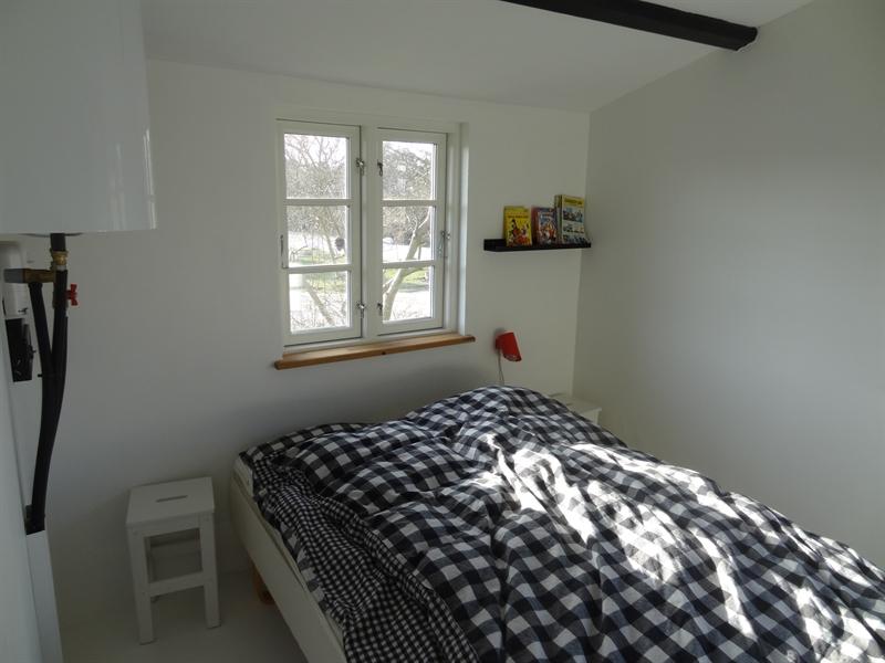 Schlafzimmer mit Doppelbett und eigenem Ausgang